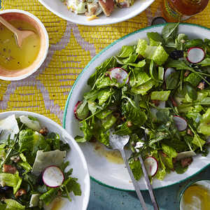 Zesty Arugula-and-Baby Romaine Salad with Candied Pecans and Shaved ReggianoRecipe