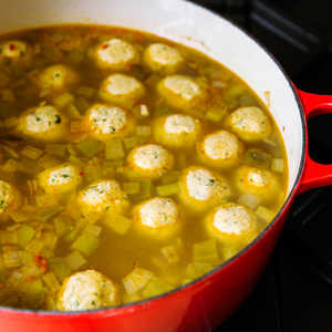 Spicy Matzo-Ball Soup with Trinity Vegetables and Hot Peppers Recipe