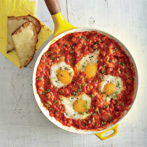 Eggs Poached in Tomato Sauce with Garlic Cheese ToastsRecipe