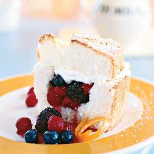 Angel Food Cake Stuffed with Whipped Cream and Berries Recipe