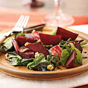 Roasted Beet and Shallot Salad over Wilted Beet Greens and ArugulaRecipe
