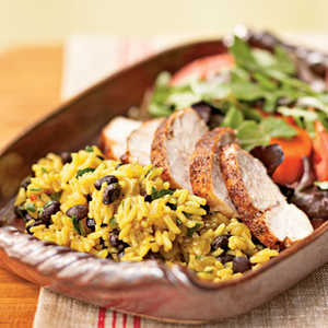 Jerk-Seasoned Turkey with Black Beans and Yellow RiceRecipe
