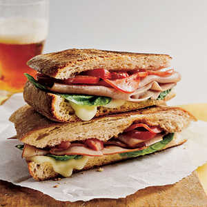 <p>Mozzarella, Ham, and Basil Panini</p>
