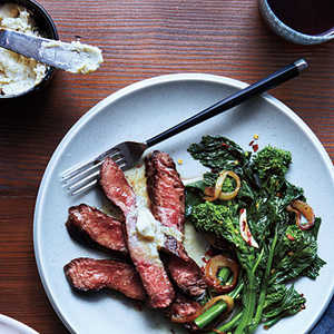 <p>Grilled Sirloin with Anchovy-Lemon Butter and Broccoli Rabe</p>