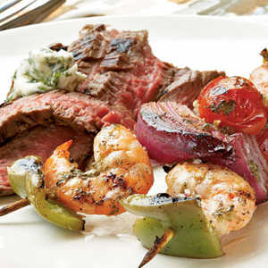 Ginger-Lime Marinated Shrimp Kebabs with Grilled Flank Steak and Cilantro ButterRecipe