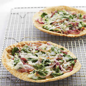 Whole Wheat Pita Pizzas with Spinach, Fontina, and OnionsRecipe