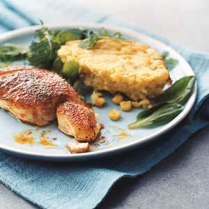 Blackened Striped Bass with Corn Spoon Bread and GreensRecipe