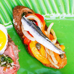 Picnic Crostini with Roasted Pepper, Onion, and Anchovy Recipe
