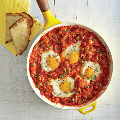 Eggs Poached in Tomato Sauce with Garlic Cheese Toasts