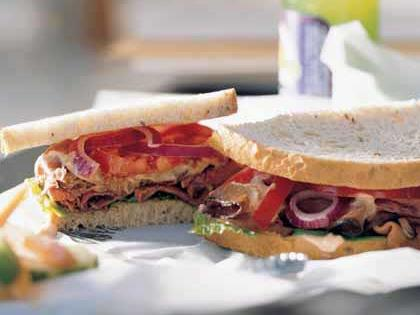 Deluxe Roast Beef Sandwich RecipeJazz up this classic sandwich with mayo, horseradish, and chili sauce for a creamy spread with a bit of heat.