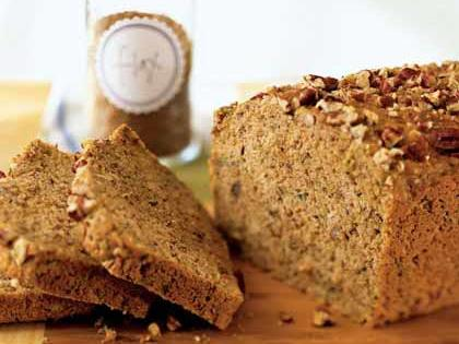 Zucchini-Pecan Flaxseed Bread RecipeStir toasted pecans into the batter of this hearty quick bread and also top the loaf with chopped pecans for baking.