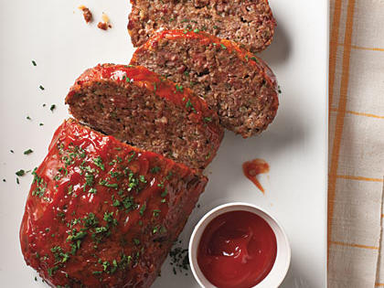 Classic Meat Loaf RecipeThis is the iconic, traditional meat loaf like your mom used to make (or that you wished your mom would make). Mix the ingredients gently, just until combined, and don't compact the meat when shaping the loaf for best results. For extra pizzazz, garnish with parsley.