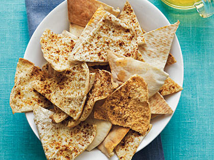 Baked Pita Chips RecipeThese chips are ideal for dipping, but still taste great alone. Double or tripple the recipe to include in your kids lunchboxes.