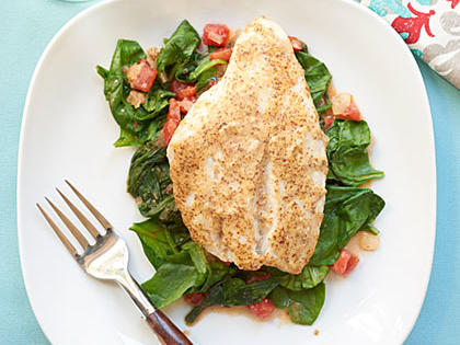 <p>Red Snapper over Sautéed Spinach and Tomatoes</p>