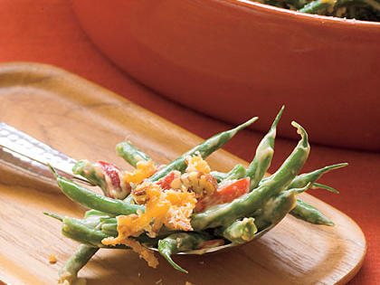 Cheddar-Pecan Green Bean Casserole RecipeToss blanched green beans with a buttermilk-Ranch dressing and top with panko breadcrumbs, crushed French-fried onions, chopped pecans, and shredded Cheddar cheese for a tasty twist on a traditional green bean casserole.