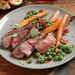 Herb-Rubbed New York Strip with Sautéed Peas and Carrots Recipe