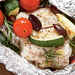 Halibut with Tomatoes, Rosemary, and Zucchini in Foil Packets Recipe